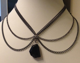 Multiple chain necklace with black glass bead