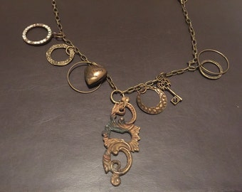 Keyhole pendant with found items