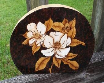 Magnolia blooms woodburned on poplar