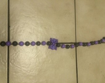 Purple and grey bow beaded necklace