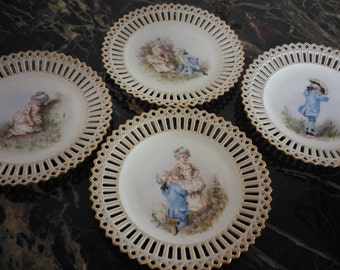 Four porcelain wall plates
