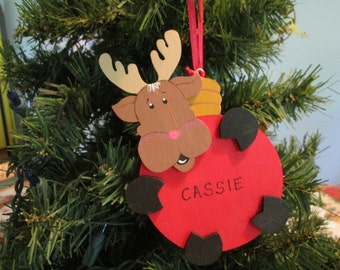 wooden deer holding oversized bulb ornament