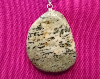 Green and cream verigated stone