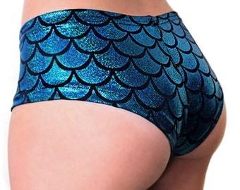 Mila,free shiping,booty shorts,womens shorts,edc shorts, cheeky shorts,uv glow,festival shorts,mermaid shorts,edm,rave,electric forest