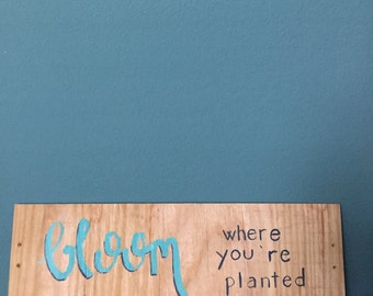 Bloom where you're planted sign