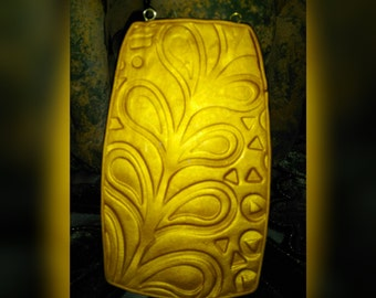 Gold tone polymer clay pendant