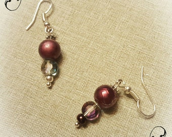Plum pearl and iridescent crystal dangle earrings.