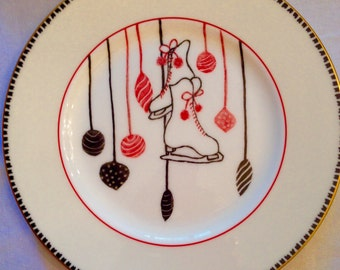 Christmas red and black ornaments on 11 inch plate