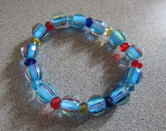 Turquoise Stretch Bracelet with Red, Royal Blue & Yellow Beads