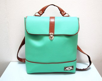 Designer  Backpack or shoulder bag, 2 in 1, brown and turquoise color