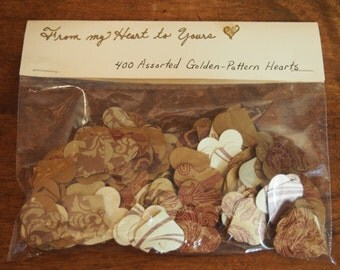 GOLD HEART CONFETTI: one-of-a-kind golden-pattern hearts--they are two-sided, so you never have to flip them!
