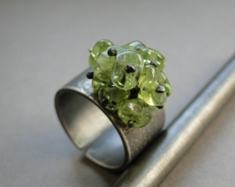 Raw sterling silver ring with olive peridot