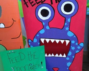 Feed the monster bean bag toss game