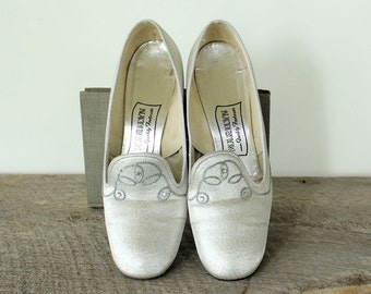 1960s silver heels, womens size 7.5 or 8 . vintage silver shoes with rhinestone details . 60s silver pumps AS IS