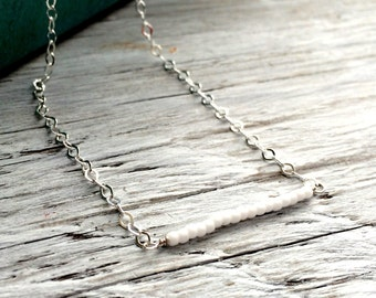 minimalist necklace white glass seed beads on sterling silver chain