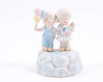 Mann 1985 Vintage Music Box Figurine Boy and Girl Standing on a Cloud with Balloons and Doll