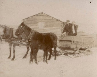 vintage photo 1911 couple ready for a two horse open sleigh ride in snow by Cabin
