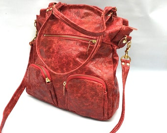 Shikotsu leather bag in distressed berry red