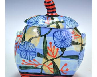 Jar, stripes with abstract flower.