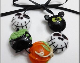 A Bead is Born handmade lampwork glass beads holiday halloween skeleton bat pumpkin witch cauldron