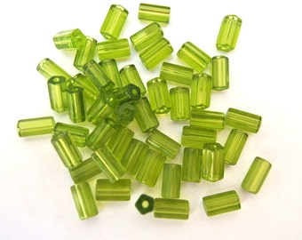 20 Vintage glass beads green, tube,bugle beads faceted, 8mmx6mm