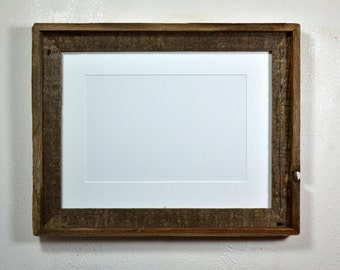 12x16 frame from reclaimed wood with beautiful patina and 8x12 white mat.