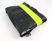 Journal, recycled bicycle inner tube, handmade blank, medium. Neon green elastic closure