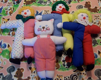 little stuffed clowns and kitty dolls