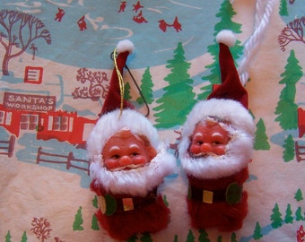 two itty bitty furry santas
