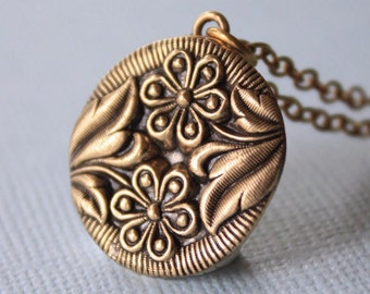 Antique double daisy bronze pendant