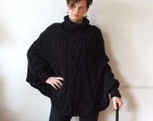 Hand knitted poncho black braided cape sweater,fall fashion cabled poncho, avant garde traffic stoper,hotest fall trend, black sweater