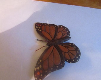 Real looking leather tooled butterfly