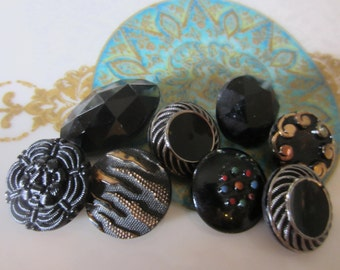 Vintage buttons, 8 assorted bronze/ gold luster over black glass, some Victorian pressed designs (jan 27b)