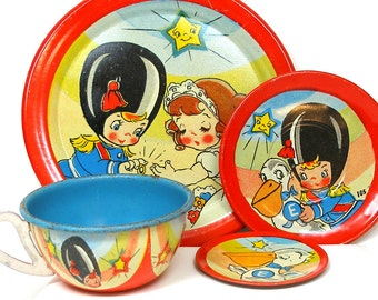 1950s Wedding, Vintage childrens tin toy tea setting, graphics by Ohio Art. Soldier, bride & pelican.