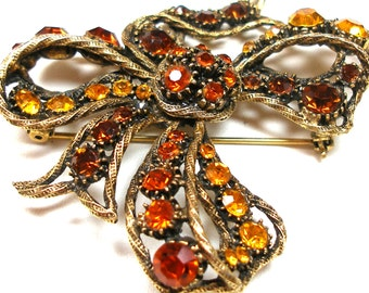 50s Weiss BOW Rhinestone brooch, Orange and topaz.
