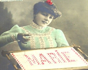 1900s French postcard, Lady with needlework, RPPC real photo postcard.