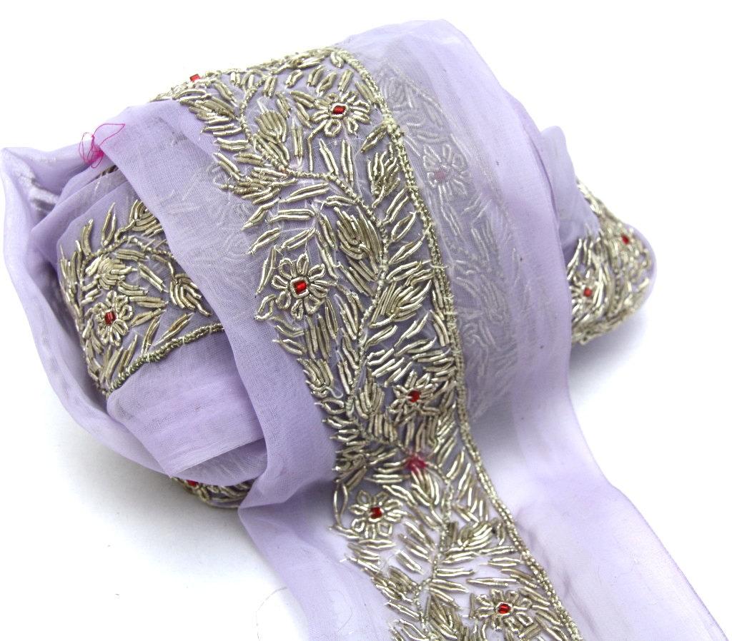 Sari trim with silver zari stitch on mauve organza formal