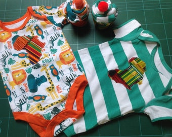 onesies bodysuit with Africa appliqué presented as a cupcake in gift box 3-9 months