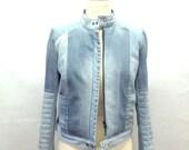 Distress jean jacket light wash