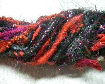 Handspun Worsted Weight Party Art Yarn in Red and Black Wool with Sparkle and Ribbon by KnoxFarmFiber for Holiday Embellishment