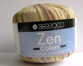 berroco zen colors ribbon yarn . raku 8108 . 110yd . italian ribbon yarn . sand taupe olive green gold matte and shiny novelty ribbon yarn