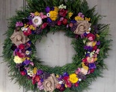 Colorful all natural dried flower wreath with burlap roses.