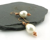 Timeless Pearls. Shimmering white pearl drops on rose coloured curved copper earwires. Classic jewellery. Feminine. Nickel free Copper.