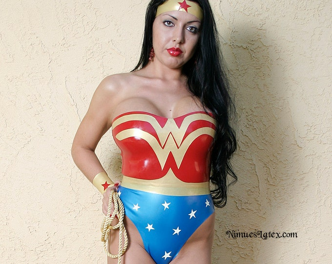 Featured listing image: Wonder Woman Costume. Includes bodysuit, wrist bands, tiara and lasso