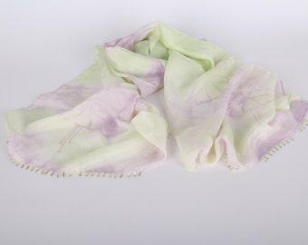 Shibori dyed, screen printed silk scarf with beaded edge.
