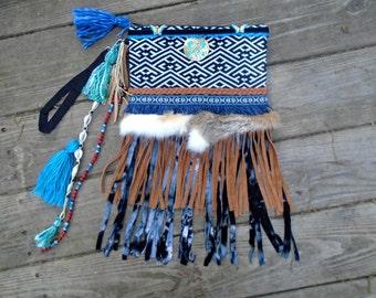 DeviDesigns Tribal Geo Woven Festival Clutch, Wristlet or Belt bag w tie dye knit fringe, Fur trim, tassels, hamsa, butterfly, cowry shells