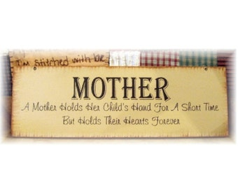 MOTHER A mother holds her child's hand for a short time but holds their hearts forever primitive wood sign