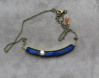 small brass arc with lapis lazuli and pyrite necklace