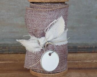 Grey hopsack ribbon on handmade wood spool