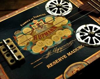 Very sweet cigar box slide guitar